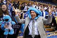 DUKE, NC - FEBRUARY 15: Broadcaster Dick Vitale poses for a photo with some Cameron Crazies during a game between Notre Dame and Duke at Cameron Indoor Stadium on February 15, 2020 in Duke, North Carolina.
