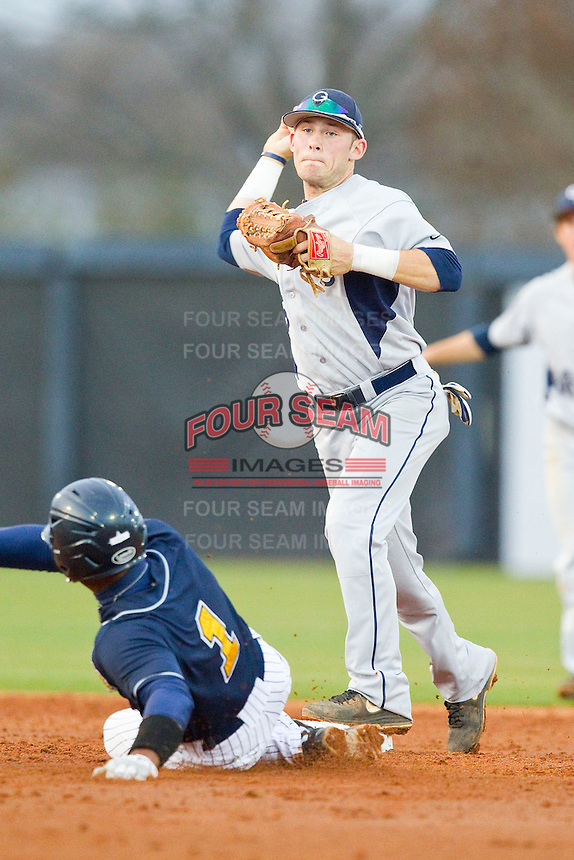 Georgia Southern Eagles second baseman Tyler Avera (5) turns a double play against the UNCG Spartans at UNCG Baseball Stadium on March 29, 2013 in Greensboro, North Carolina.  The Spartans defeated the Eagles 5-4.  (Brian Westerholt/Four Seam Images)