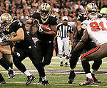 December 2009: New Orleans Saints running back Mike Bell (21) runs with the ball during an NFL football game at the Louisiana Superdome in New Orleans.  The Buccaneers defeated the Saints 20-17.