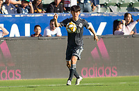 CARSON, CA - SEPTEMBER 29: Hwang In-Beom #4 of the Vancouver Whitecaps moves to the ball during a game between Vancouver Whitecaps and Los Angeles Galaxy at Dignity Health Sports Park on September 29, 2019 in Carson, California.