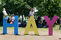 Pictured: Children climb on the giant HAY letters<br /> Re: Hay Festival at Hay on Wye, Powys, Wales, UK. Saturday 02 June 2018