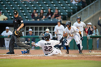 Northwest Arkansas Naturals catcher Meibrys Viloria (22) safely slides into home for a run on May 13, 2019, at Arvest Ballpark in Springdale, Arkansas. (Jason Ivester/Four Seam Images)