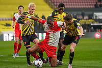 Will Hughes of Watford, Uche Ikpeazu of Wycombe Wanderers and Tom Cleverley of Watford during the Sky Bet Championship behind closed doors match between Watford and Wycombe Wanderers at Vicarage Road, Watford, England on 3 March 2021. Photo by David Horn.