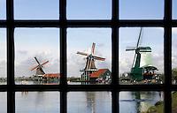 Zaanstad-  Molens bij Zaanse Schans. Openluchtmuseum aan de Zaan gefotgrafeerd door het raam van een molen
