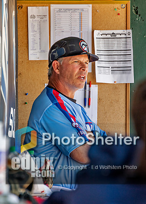 23 June 2019: New Hampshire Fisher Cats Manager Mike Mordecai looks out from the dugout prior to a game against the Trenton Thunder at Northeast Delta Dental Stadium in Manchester, NH. The Thunder defeated the Fisher Cats 5-2 in Eastern League play. Mandatory Credit: Ed Wolfstein Photo *** RAW (NEF) Image File Available ***