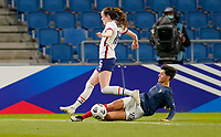 LE HAVRE, FRANCE - APRIL 13: Rose Lavelle #16 of the United States is tackled by Élisa de Almeida #22 of France during a game between France and USWNT at Stade Oceane on April 13, 2021 in Le Havre, France.
