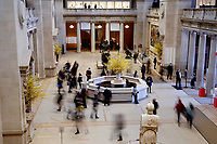 NEW YORK, NEW YORK - MARCH 19: People walk in the lobby of The MET Museum on March 19, 2021 in New York. The Met Museum is considering selling some of its works to support itself after claming that the pandemic has caused a loss of revenue of $150 million in about 18 months. (Photo by John Smith/VIEWpress)