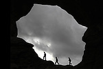 Children playing at Double Arch in Arches National Park, Moab, Utah, USA. .  John offers private photo tours in Arches National Park and throughout Utah and Colorado. Year-round.