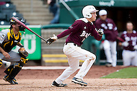 Eric Cheray #14 of the Missouri State Bears follows through his swing after making contact on a pitch during a game against the Wichita State Shockers at Hammons Field on May 5, 2013 in Springfield, Missouri. (David Welker/Four Seam Images)