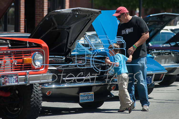 Dominic Martinelli and his son Lucas, 6, look at classic car engines during Legends of the West in Carson City, Nev., on Saturday June 22, 2013.<br /> (Photo by Kevin Clifford/Nevada Photo Source)
