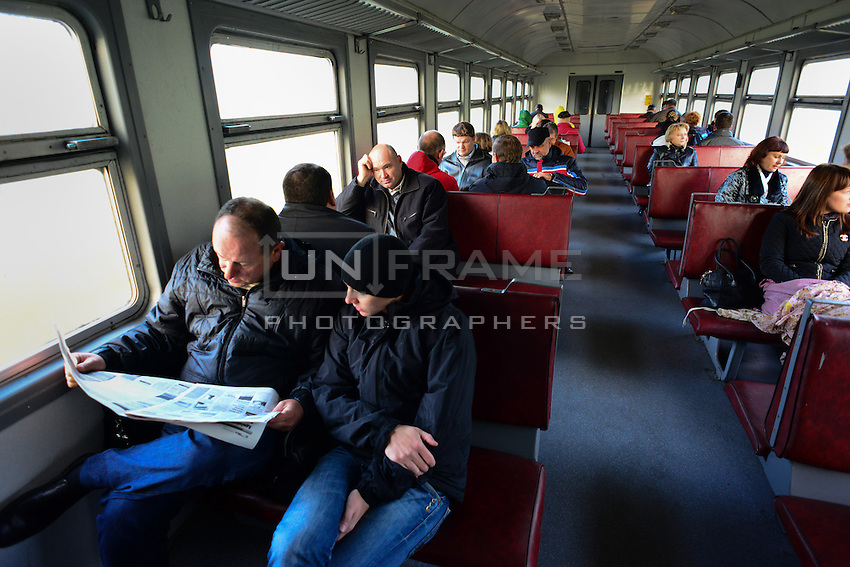 Workers of Chernobyl Nuclear Power Plant reading paper with job offers on their way to work. Special train is connects Slavutich city and territory of the plant. Train has no stops, crosses official Belarusian border and returns to Ukraine. It takes approximately 40 minutes to get to destination.