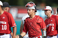 Jack Conley (23) of the North Carolina State Wolfpack shakes hands with the Army Black Knights following the game at Doak Field at Dail Park on June 3, 2018 in Raleigh, North Carolina. The Wolfpack defeated the Black Knights 11-1. (Brian Westerholt/Four Seam Images)