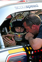 Feb 20, 2009; Fontana, CA, USA; NASCAR Sprint Cup Series driver Scott Speed talks to a crew member during qualifying for the Auto Club 500 at Auto Club Speedway. Mandatory Credit: Mark J. Rebilas-