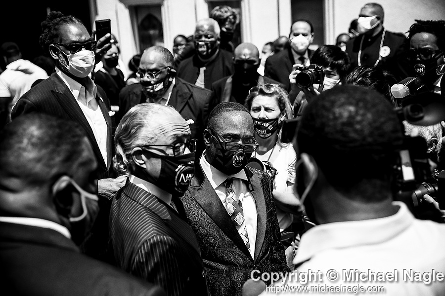 Al Sharpton, left, and Michael Tucker, founder of Lay the Guns Down, center, speak to the media at the funeral for one year-old Davell Gardner Jr. at Pleasant Grove Tabernacle on July 27, 2020 in the Brooklyn borough of New York City.  Gardner was shot and killed earlier this month during a cookout in front of his home along with three others.  Photograph by Michael Nagle