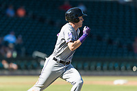 Salt River Rafters first baseman Tyler Nevin (2), of the Colorado Rockies organization, hustles towards first base during an Arizona Fall League game against the Mesa Solar Sox at Sloan Park on October 30, 2018 in Mesa, Arizona. Salt River defeated Mesa 14-4 . (Zachary Lucy/Four Seam Images)