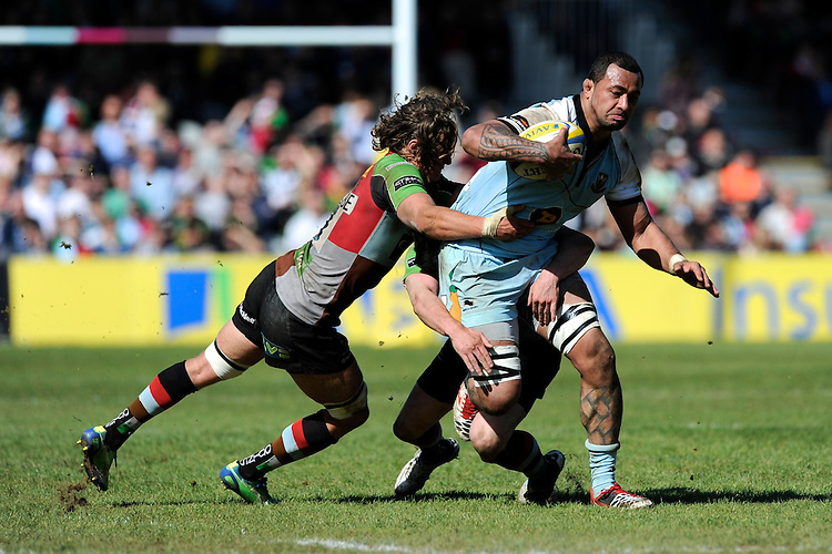 Samu Manoa of Northampton Saints is tackled by Luke Wallace of Harlequins during the Aviva Premiership match between Harlequins and Northampton Saints at the Twickenham Stoop on Saturday 4th May 2013 (Photo by Rob Munro)