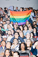 A man holds a Pride flag during a speech at the Democratic National Convention at the Wells Fargo Center in Philadelphia, Pennsylvania, on Wed., July 27, 2016.