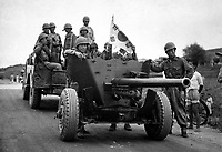 During South Korean evacuation of Suwon Airfield, a 37-mm anti-tank gun is hauled out of the area for repairs, by a weapons carrier.  1950.  INP.  (USIA)<br /> Exact Date Shot Unknown<br /> NARA FILE #:  306-PS-50-9064<br /> WAR & CONFLICT BOOK #:  1387