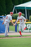 Auburn Doubledays third baseman Cole Daily (7) is congratulated by manager Jerad Head (11) as he rounds third base after hitting a home run in the top of the ninth inning during a game against the Batavia Muckdogs on September 1, 2018 at Dwyer Stadium in Batavia, New York.  Auburn defeated Batavia 10-5.  (Mike Janes/Four Seam Images)