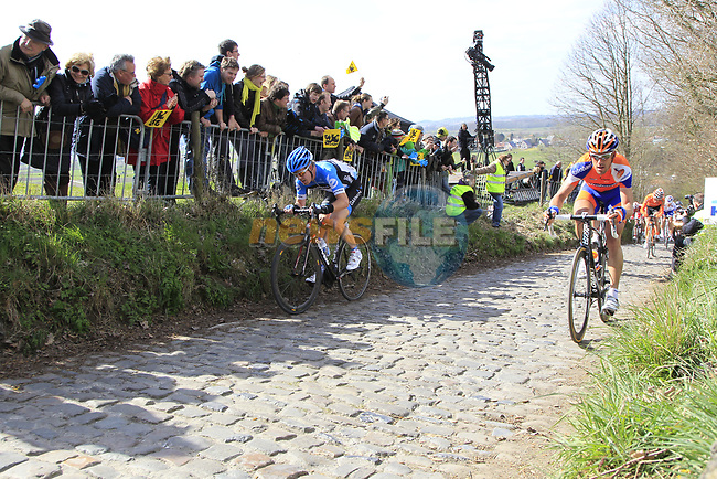 The breakaway group including Tyler Farrar (USA) Garmin-Barracuda and Maarten Tjallingii (NED) Rabobank climb Koppenberg during the 96th edition of The Tour of Flanders 2012, running 256.9km from Bruges to Oudenaarde, Belgium. 1st April 2012. <br /> (Photo by Eoin Clarke/NEWSFILE).