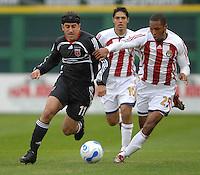 2006 MLS Regular Season Match at RFK Stadium, DC United Midfielder Alecko Eskandarian fighting for the ball against defender from Chivas Usa Lawson Vaughn,  final score DC United 2  , Chivas USA 0  , Saturday, April 8.