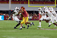 LOS ANGELES, CA - SEPTEMBER 11: Kyu Blu Kelly #17 and Levani Damuni #3 of the Stanford Cardinal prepare to tackle Vavae Malepeai #6 of the USC Trojans during a game between University of Southern California and Stanford Football at Los Angeles Memorial Coliseum on September 11, 2021 in Los Angeles, California.