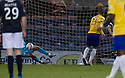 Dundee keeper Kyle Letheren saves Cowdenbeath's Kane Hemmings penalty kick.