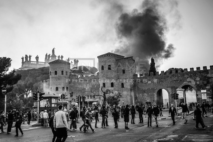 A dense cloud of black smoke is raised high after a Carabinieri (military police) truck is set on by outraged fringes of  rioters in Piazza San Giovanni.  Rome, Italy. 15/10/2011