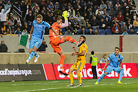 HARRISON, NJ - MARCH 11: Nahuel Guzman #1 of Tigres UANL grabs a ball as Alexander Ring #8 of NYCFC goes for the header during a game between Tigres UANL and NYCFC at Red Bull Arena on March 11, 2020 in Harrison, New Jersey.