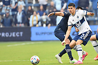 KANSAS CITY, KS - MAY 16: Cristian Gutierrez #3 Vancouver Whitecaps with the ball during a game between Vancouver Whitecaps and Sporting Kansas City at Children's Mercy Park on May 16, 2021 in Kansas City, Kansas.