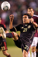 Mexico national team defender Edgar Duenas (20) with a clearing ball. The national teams of Mexico and Venezuela played to a 1-1 draw in an International friendly match at  Qualcomm stadium in San Diego, California on  March 29, 2011...
