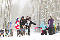 Matt Failor, of Mansfield, Ohio, greets the crowd along a wooded portion of trail at the 2012 Iditarod Ceremonial Start, Anchorage, AK.
