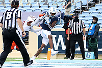 CHAPEL HILL, NC - OCTOBER 10: Dyami Brown #2 of North Carolina catches a 43-yard touchdown pass under pressure from Jermaine Waller #28 of Virginia Tech during a game between Virginia Tech and North Carolina at Kenan Memorial Stadium on October 10, 2020 in Chapel Hill, North Carolina.