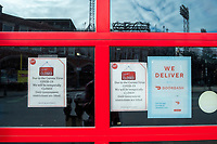 """Sal's Pizza, across the street from Fenway Park, has closed temporarily during the ongoing Coronavirus (COVID-19) global pandemic in Boston, Massachusetts, seen here on Wed., Jan. 6, 2021. A sign in the window states that it will reopen when """"government restrictions are lifted."""""""