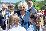Camilla, Dutchess of Cornwall speaks to local schoolchildren during a visit to Victoria Park in Swansea today with Prince Charles to help celebrate the 50th anniversary of Swanseas achieving City status.