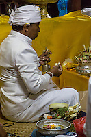 Denpasar, Bali, Indonesia.  Hindu Priest Praying in Religious Ceremony on Occasion of the Full Moon.  Pura Jagatnatha Temple.