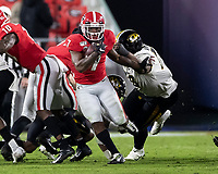 ATHENS, GA - NOVEMBER 09: D'Andre Swift #7 of the Georgia Bulldogs evades a tackle by Kobie Whiteside #78 of the Missouri Tigers during a game between Missouri Tigers and Georgia Bulldogs at Sanford Stadium on November 09, 2019 in Athens, Georgia.