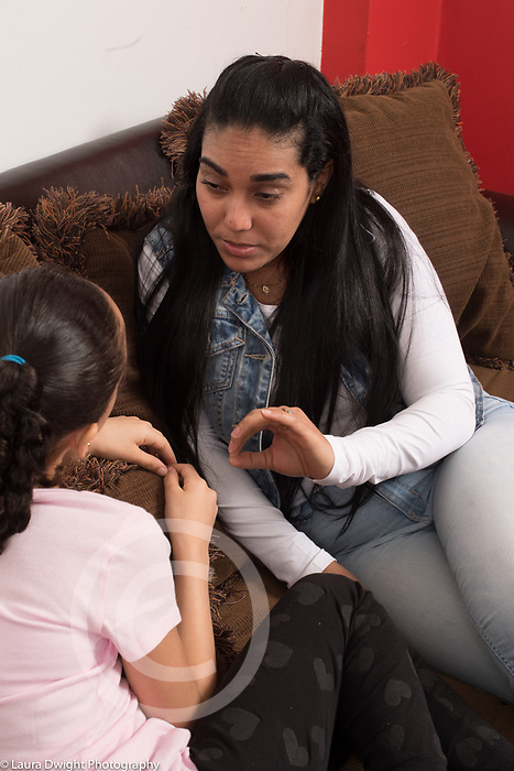9 year old girl having discussion with mother, conflict, argument