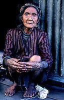 Circa 1990 - Near Bontoc, old women with traditional Body Tattoo.