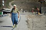 A Roma woman walks through the Maxsuda neighborhood of Varna, Bulgaria, an area where many Turkish-speaking Roma live.