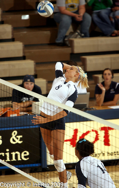 SIOUX FALLS, SD - SEPTEMBER 29:  Jordan Spatenka #8 of Augustana winds up for a kill attempt against St. Cloud State University in the second game of their match Tuesday night at the Elmen Center. (Photo by Dave Eggen/Inertia).