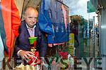 Micheal Moran of Ryle Menswear getting the Christmas window ready.