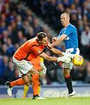 Kenny Miller challenges goalkeeper Sebastian Flauss
