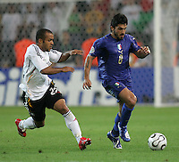 Gennaro Gattuso, David Odonkor.  Italy defeated Germany, 2-0, in overtime in their FIFA World Cup semifinal match at FIFA World Cup Stadium in Dortmund, Germany, July 4, 2006.