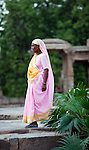 June 21 2012, New Delhi, India: A sari clad woman walks the grounds at Qutub Minar  a UNESCO World Heritage Site in Delhi,India. The Qutub Minar was constructed with red sandstone and marble, and is the tallest minaret in India,with a height of 72.5 meters and contains 379 stairs to reach the top.         Picture by Graham Crouch/Holland Herald