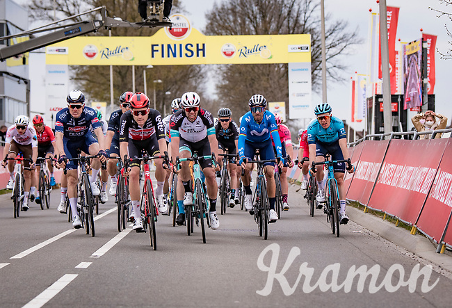 The bunch behind the winning trio with the likes of Michael Matthews (AUS/BikeExchange) & Alejandro Valverde (ESP/Movistar)<br /> <br /> 55th Amstel Gold Race 2021 (1.UWT)<br /> <br /> 1 day race from Valkenburg to Berg en Terblijt; raced on closed circuit (NED/217km)<br /> <br /> ©kramon