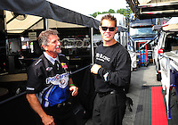 Sept. 30, 2011; Mohnton, PA, USA: NHRA crew members for funny car driver Leah Pruett during qualifying for the Auto Plus Nationals at Maple Grove Raceway. Mandatory Credit: Mark J. Rebilas-