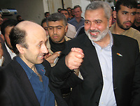 "British Broadcasting Corporation reporter Alan Johnston, left, and former Palestinian Prime Minister Ismail Haniyeh of Hamas raise their hands as they meet following Johnston's release in Gaza City, Wednesday, July 4, 2007. Johnston was released early Wednesday after nearly four months in captivity in the Gaza Strip.""photo by Fady Adwan"""