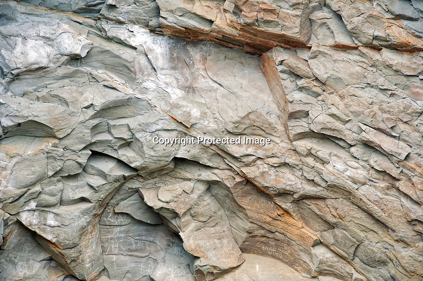 A crumbling cliff wall shows a pattern of rock layers. During the late summer at Sunset Bay, Oregon.