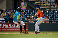 St. Lucie Mets shortstop Manny Rodriguez (13) looks to tag Dylan Busby (28) during a Florida State League game against the Bradenton Barbanegras on July 27, 2019 at LECOM Park in Bradenton, Florida.  Bradenton defeated St. Lucie 3-2.  (Mike Janes/Four Seam Images)